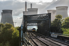 Dwarfed (Richard Croft136) Tags: brotherton railway bridge ferrybridge power station back lit sunny bright class 66 ews railways train trains cooling towers chimney c coal clag smoke river sun sunburst nikon d800 2470 f28 hta hoppers pontefract castleford