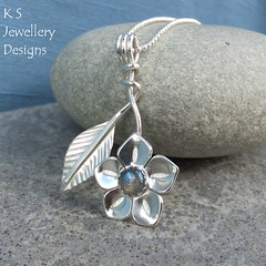 Labradorite Flower & Leaf Sterling Silver Pendant (KSJewelleryDesigns) Tags: metalwork flower pendant necklace jewellery jewelry handmade brightsilver shine sterlingsilver silverjewellery handcrafted silver silverwire metal hammered shiny polished bright soldered soldering brushed flowers petals sawing piercing silversmith silversmithing daisy daisies blooms blossom gemstone cabochon flowerpendant swirlblossom texture stamens organic wirework stonesetting labradorite flowerandleaf leaf