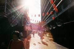 Warm Fuzzy Sunday (khai_nomore) Tags: film 35mm slr canona1 petalingstreet kualalumpur streetphorography urban flare autaut