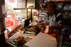 The proud shopkeeper ( V ) Tags: turkey turkiye torokorszag anadolu anatolia cappadocia kapadokya goreme uchisar ibrahimpasa ortahisar landscape tunnel medieval troglodyte geology rockformations people shopkeeper turkish sandwich tost