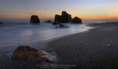 Tra le rocce e l'acqua (Sas919) Tags: sunset landscape photo photography canon sicily italy tramonto longexposition nature
