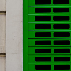 Serranda verde. Green shutter (grids) (sandroraffini) Tags: minimalismo minimalism abstract reality shutter green pattern geometry grids griglie urban details exploration spagna spain colors valencia street sandroraffini canon 70200 vibrant verde optical