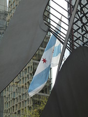 Chicago, Daley Plaza, Illinois State Flag through the Picasso Sculpture (Mary Warren (6.8+ Million Views)) Tags: sculpture chicago abstract art lines reflections flag curves diagonal wbez pablopicasso chicagoist explorechicago flickrdiamond rubyphotographer