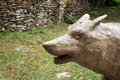 wolf statue outdoors (Mimadeo) Tags: park old sculpture nature grass statue stone dangerous ancient wolf outdoor beast