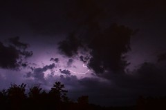 Between the Clouds (skippyclese) Tags: trees sky storm night clouds dark lightning