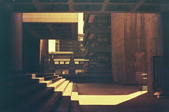 Ascension (The New Motive Power) Tags: city shadow urban blur london film architecture modern stairs analog vintage concrete estate centre grain arts lofi modernism structure barbican frame distance fed complex brutalism fed5 brutalist lomographic redscale