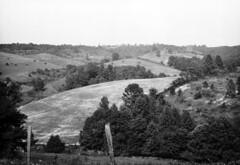 Farmland  Jackson County, Ohio (Pythaglio) Tags: county trees ohio fence landscape liberty neglected scenic rail farmland jackson hills ridge fields split township 1927 mccune