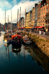 warm autumn sunshine illuminates boats and reflections in the Vieux Bassin and Quai St Catherine, Honfleur, Normandy, France (grumpybaldprof) Tags: tamron 16300 16300mm tamron16300mmf3563diiivcpzdb016 honfleur normandy normandie france vieuxbassin oldharbour quaistecatherine quaiquarantaine quai quaistetienne stecatherine lalieutenance quarantaine water boats sails ships harbour historic old ancient monument picturesque restaurants bars town port colour lights reflection architecture buildings mooring sailing stone collombage halftimbered yachts carousel merrygoround reflections waterreflections wetreflectionsfunfair autumn sunshine autumnsunshine warm warmcolours intense hdr colourhdr marina dock
