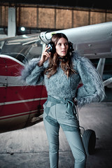 The Aviatress (Camille Marotte) Tags: 2016 argentina natalia ostrofsky portrait fashion beauty plane airplane hangar clothes fabric style styling natural light camillemarotte canon sigma 1dc headset soft hair haute couture desaturated colors vintage