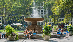 2016 - New York City - Bryant Park (Ted's photos - For Me & You) Tags: 2016 cropped nikon nikond750 nikonfx nyc newyorkcity tedmcgrath tedsphotos vignetting josephineshawlowellmemorialfountain bryantpark bryantparknyc josephineshawlowellmemorialfountainnyc fountain seating seated seats park umbrellas streetscene parkscene shadows people peopleandpaths backpack