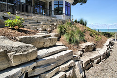 Fond du Lac Outcroppings and Wall Stone (Buechel Stone) Tags: naturalstone buildingstone stoneveneer thinveneer fullveneer stone buechelstone stoneexterior outdoorliving retainingwalls retainingwall landscapingideas