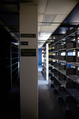 (John Donges) Tags: laboratory old disused science equipment room library shelves stacks sign journals 8760