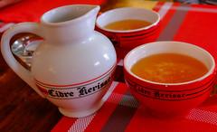Cidre (canong2fan) Tags: jug france fujinonxf27mmf28 fujifilmxe2 cidre cider guerande kerisac europe eu bowls red piriacsurmer indoor restaurant cup beverage drink alcohol