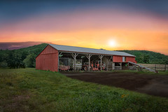 End of day at the cattle farm. (Trotter Jay) Tags: wallingfordct wallingford farm sunset farmequipment dairyfarm cattlefarm barn redbarn scenicct scenicnewengland landscapephotography nikond7100
