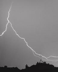 Lightning. Leucate, France. (BadGunman) Tags: hill thunderstorm eclair sky white black noiretblanc church blacknwhite cross leucate france blackandwhite lightning