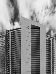 facade with clouds (paologmb) Tags: bn skyscraper building tower arquitectura facade leicamtyp240 architecture windows blackandwhite miami bw