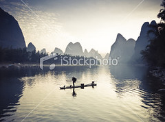 Fishermen on li river (MPBHAIBO) Tags: china morning cloud mist mountain reflection bird water fog sunrise river landscape dawn liriver fishing fisherman asia dusk guilin yangshuo hill cormorant  relaxation  cloudscape stormcloud cumulonimbus  chineseculture  xingping ruralscene fishingindustry   karstformation chineseethnicity woodenraft  guangxiregion