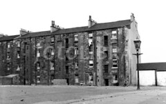 FOT693131 (Peter Guidi) Tags: street old city houses homes urban white black architecture youth scotland moody glasgow historic rubbish decrepit residential atmospheric slum dilapidated 1961 pram tenements squalor gorbals deprivation nineteensixties