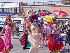Coney Island Mermaid Parade - 2013 (UrbanphotoZ) Tags: nyc newyorkcity ny newyork man tattoo brooklyn umbrella coneyisland wave parasol carmenmiranda mermaid mermaidparade clownnose cantalope purplewig blueglasses