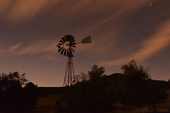 Forgotten Power (DirtyBootPrints) Tags: old light summer sky motion abandoned nature windmill night clouds rural skyscape stars landscape fun movement exposure alone power angle artistic wind time country experiment nightsky