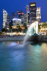 Merlion at night (lunarlynx) Tags: street city longexposure travel blue sky travelling tourism water fountain skyline night canon evening singapore cityscape waterfront skyscrapers dusk famous sightseeing scenic culture professional explore destination 5d canon5d bluehour exploration sights merlion singapura touristic cityview waterscape marinabay famousplaces famoussights   5dmarkii
