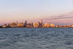 Moonrise over the City (andrewOZimages) Tags: sunset moon buildings moonrise scapes portphillipbay hobsonsbay