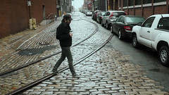 tracks (Benzadrine) Tags: nyc winter people newyork reflection wet brooklyn tracks dumbo cobblestone streetphoto vision:outdoor=0971