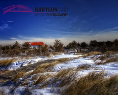Snowy Boathouse (Babylon and Beyond Photography) Tags: blue roof winter red lighthouse snow beautiful landscape island fire gold snowy january peaceful brush historic boathouse snowfall fireisland kismet babylonandbeyond