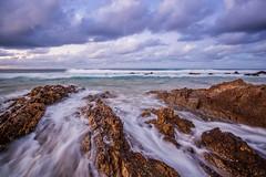 Snapper Rocks (Mcguigan Visuals) Tags: ocean longexposure beach clouds canon sand rocks australia slowshutter queensland goldcoast snapperrocks 5dmkii
