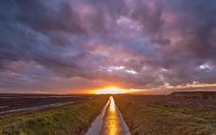 Stormy Sunset (koos.dewit) Tags: sunset sun storm clouds canon reflections zonsondergang thenetherlands wolken groningen zon 6d 2014 spiegelingen harkstede 1740mml koosdewit