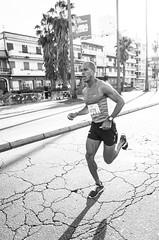 Aguelmis Rojas winner of Corr Montevideo -21Km | 140608-0013760-jikatu (jikatu) Tags: bw uruguay marathon run gr montevideo 162 ricoh corrida halfmarathon rambla jikatu