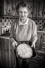Ag Déanamh Aráin / Making Bread 15 (soilse) Tags: 2009 anghaeltacht cnocastolaire deireadhfómhair donegal dúnnangall gaeltacht gweedore ireland mum october october2009 tateandlyle tírchonaill agbacáil agdéanamharáin arm arán baking bakingtin blackandwhite bread breadmaking ceird cisteanach cistin concentration craft daylight daylightportrait flour glassjars greased greasedbakingtin greasedtin hands ingredients jars kitchen makingbread monochrome naturallight portrait portraiture portráid raising sultanas table tins toirtín treacle tábla éirinn