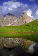 Loving mountains (Robyn Hooz) Tags: paledisanmartino pale riflesso reflection nuvole clouds erba weed mirror sky cielo veneto castrozza segantini baita
