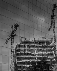 Carry That Weight (Martyn.A.Smith) Tags: construction crane building tower clouds outdoors glass reflection daytime monochrome fujifilm xti coventry warwickshire