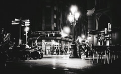 Stretching before the rendezvous... (elgunto) Tags: street people night barcelona jaumei nightlife waiting rendezvous citylights blackwhite bw sonya7 zeiss50mm17 planar cy manuallense