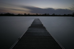 Calm sunset (Russell Discombe) Tags: southcerney longexposure sunset clouds jetty yellow orange nikon d3300 ndfliter 10stop sigma1020mm gloucestershire lake water landscape blue outdoor