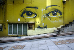 Cat Street Eyes, Hong Kong (JebbiePix) Tags: graffiti eyes face yellow street photography urban city streetphotography citylife illustration