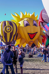 Balloon Fiesta 2016 | Sunny Boy Is Up | Morning Ascension, 07:38AM (Facundity) Tags: albuquerqueinternationalballoonfiesta aibf balloonfiesta2016 balloonfiestapark newmexico hotairballoons morningascension specialshapes specialshapesrodeo streetphotography eventphotography morning naturallight canon5dmkiv ef70200mmf4lisusm