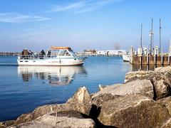 Fishermen Return (HJharland5) Tags: outdoor waterfront boat water vehicle landscape seasisde shore sea lake lakeerie ohio cleveland olympus fishing fishermen fall harbor dock