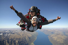 Indian girl skydiving over Lake Wakatipu (NZONE Skydive) Tags: newzealand skydiving southisland queenstown skydive parachuting parachute freefall tandemskydive tandemskydiving freefalling