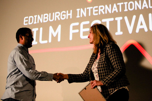 Director Mahdi Fleifel receiving the Award for Best Film In The International Competition from Siobhan Synnot for his film A World Not Ours