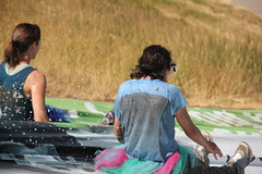 Lisa and Jalila going down the slide 1 (Aggiewelshes) Tags: utah lisa august 5k mudrun funrun wellsville 2013 jalila americanwestheritagecenter awhc manvsmud