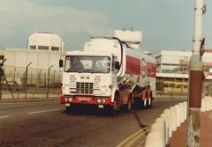ESSO Seddon Atkinson , XTM532X . Heathrow  29/3/84 (busmothy) Tags: airport heathrow esso tanker fuel atkinson seddon londonairport seddonatkinson aircraftrefuellingtanker xtm532x