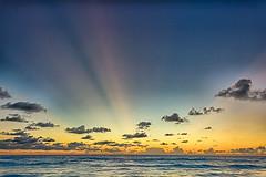 Sunbeams (MigueelRoojas) Tags: sol beach sunrise de playa amanecer cancun sunbeams rayos