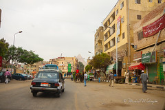 The Town of Giza (Sound Quality) Tags: africa road street travel people tourism canon landscape town village pyramid taxi egypt streetphotography cairo egyptian giza canon50d michaelwashington spirit7628yahoocom httpwwwtumblrcomblogsoundquality