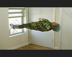 float (jon_freeze) Tags: man feet window hat photoshop canon skinny floating levitation jeans camouflage float softbox 28135mm reflector beenie speedlite xti