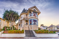 Dr. Hart's Mansion - Pacific Grove, CA (Axe.Man) Tags: ocean california blue sunset panorama sun lighthouse house architecture stairs butterfly hotel bay monterey bed day pacific grove pano victorian hart mansion pacificgrove bedbreakfast hdr