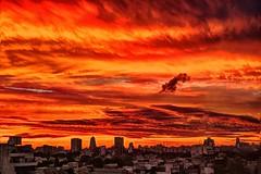 Nube solitaria - Lonely cloud (celta4) Tags: city sunset red argentina clouds buildings rojo edificios buenosaires ciudad nubes ocaso hdr vision:sunset=0932 vision:outdoor=0839 vision:sky=0893 vision:clouds=0792