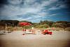 , (Benedetta Falugi) Tags: blue red sea summer sky orange sun green film beach sunshine analog umbrella landscape sand day tuscany 22mm eximus benedettafalugi wwwbenedettafalugicom