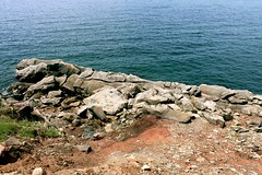 Rock Climbing (photawwgraphy) Tags: ocean travel blue canada me nature water rocks novascotia roadtrip bouldering capebreton coastline rockclimbing atlanticocean eastcoast cabottrail
